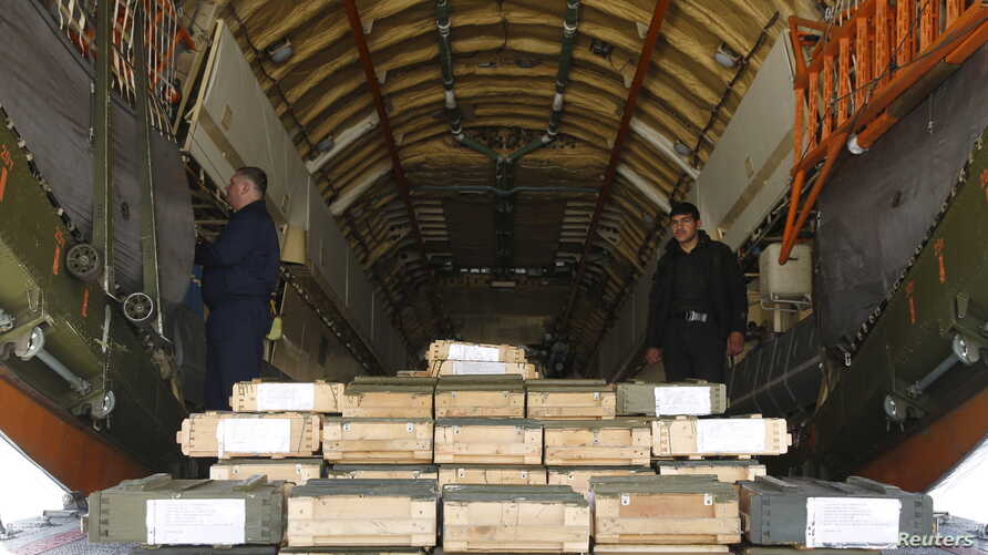 Boxes of ammunition are seen inside a Russian aircraft at the International Kabul Airport, Afghanistan, Feb. 24, 2016. Afghan officials took delivery of 10,000 automatic rifles and millions of rounds of ammunition as a gift from Russia on Wednesday