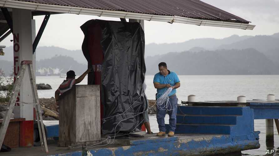 A marine gas station is shut down as it prepares for the arrival of Hurricane Earl, in Puerto Barrios, Guatemala, Tuesday, Aug. 3, 2016.