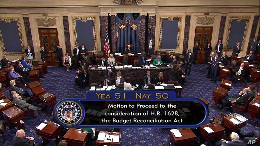Image from video provided by C-SPAN2 shows the final Senate vote, with Vice President Mike Pence's vote, to start debate to tear down much of the Obama health care law, July 25, 2017, on the floor of the Senate on Capitol Hill in Washington.
