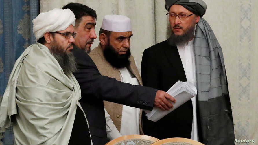 FILE - Members of Taliban delegation take their seats during the multilateral peace talks on Afghanistan in Moscow, Nov. 9, 2018.