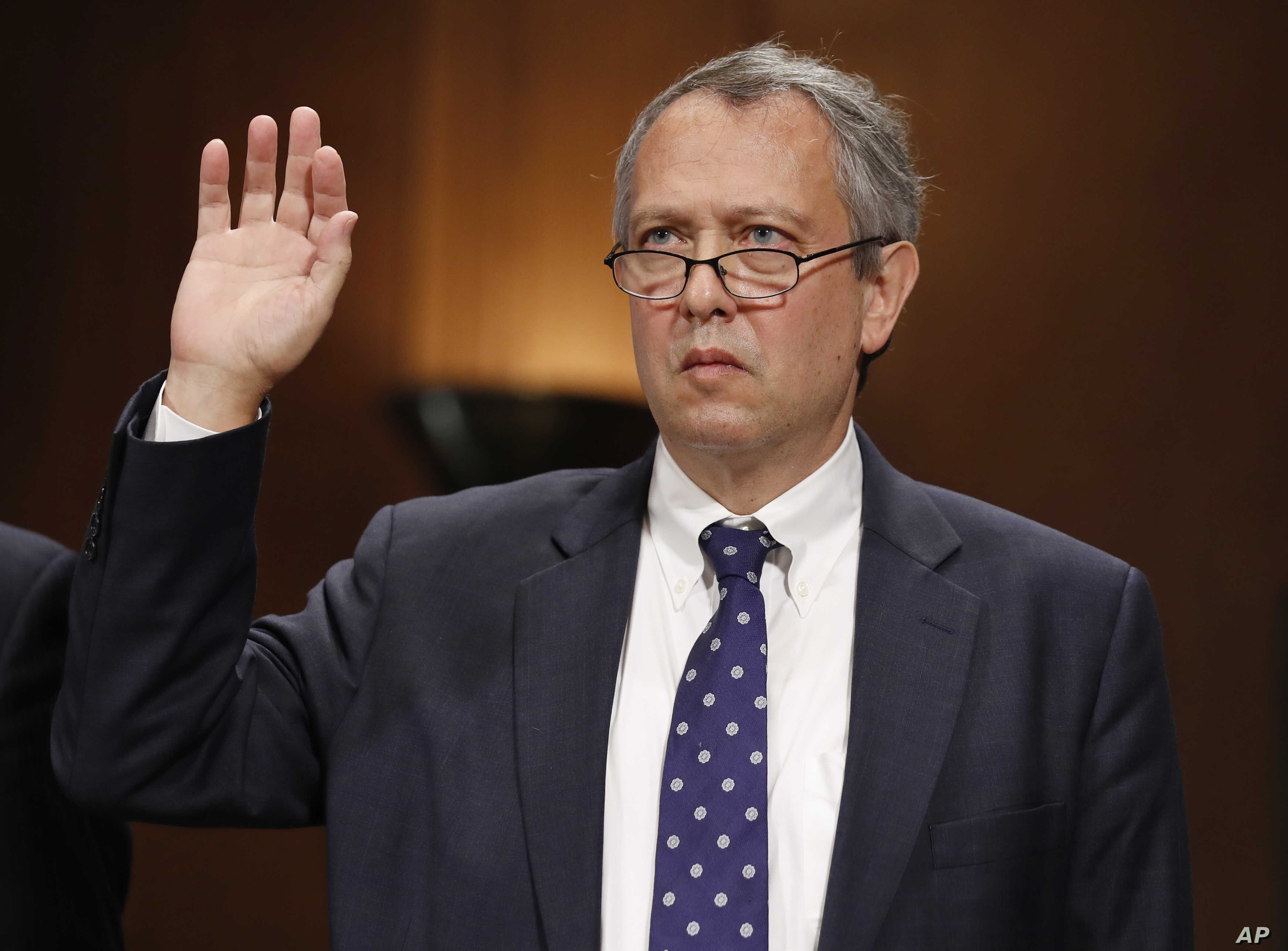 FILE - In this Sept. 20, 2017, file photo, Thomas  Farr is sworn in during a Senate Judiciary Committee hearing on his nomination to be a District Judge on the United States District Court for the Eastern District of North Carolina, on Capitol Hill i