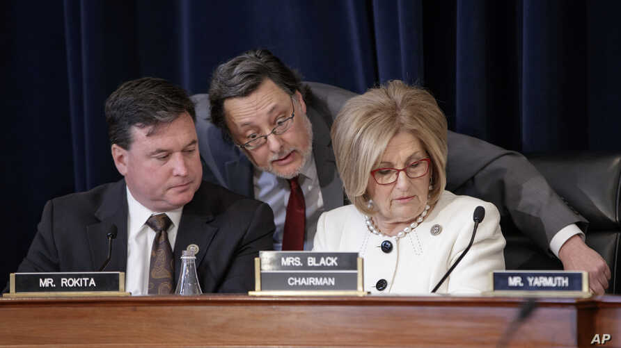 House Budget Committee Chair Diane Black, R-Tenn., (R), joined at left by Rep. Todd Rokita, R-Ind., and panel staff member Jim Bates (C), works on the Republican health care bill, on Capitol Hill in Washington, March, 16, 2017.