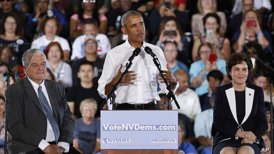 Former President Barack Obama speaks at a rally in support of candidate for Senate Rep. Jacky Rosen, D-Nev., right, and Clark County Commission Chair and Democratic gubernatorial candidate Steve Sisolak, left, in Las Vegas, Oct. 22, 2018.