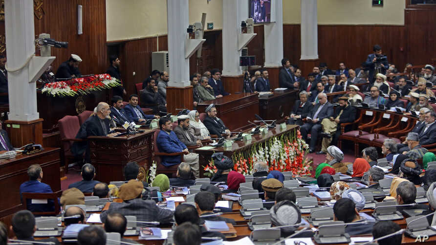 Afghan President Ashraf Ghani, center left, makes an address as he inaugurates a new session of parliament at the parliament house in Kabul, Afghanistan, March 7, 2015.