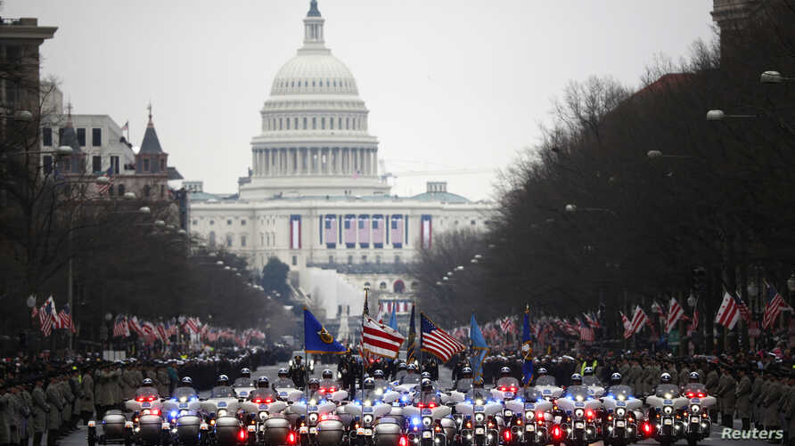 Washington, D.C., motorcycle police lead the inaugural parade for U.S. President Donald Trump after he was sworn in at the Capitol (background) in Washington, D.C., Jan. 20, 2017.