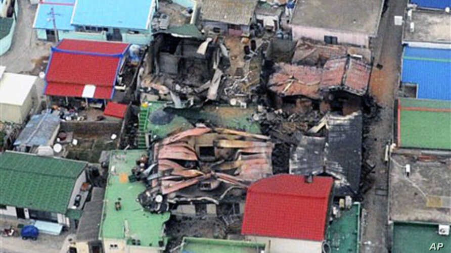 An aerial view shows destroyed houses on Yeonpyeong island, South Korea, 24 Nov 2010, one day after North Korea's artillery attack on the island