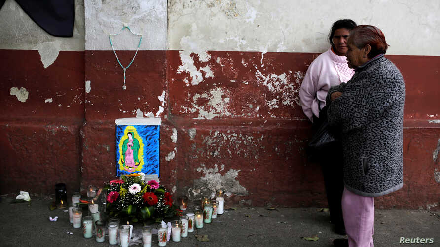 Family members wait outside the morgue where the bodies of victims were taken after a fire at the Virgen de Asuncion home in San Jose Pinula near Guatemala City, March 9, 2017.