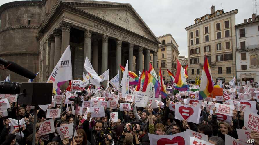 Activists demonstrate in favor of rights for gay couples prior to a debate to be opened in Italian parliament to change laws on recognition of rights for same-sex couples, in Rome, Jan. 23, 2016. (