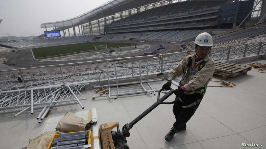 A laborer works at the Incheon Asiad Main Stadium that is being built for the 17th Asian Games in Incheon April 10, 2014. Vietnam has decided not to host the  2019 Asian Games.