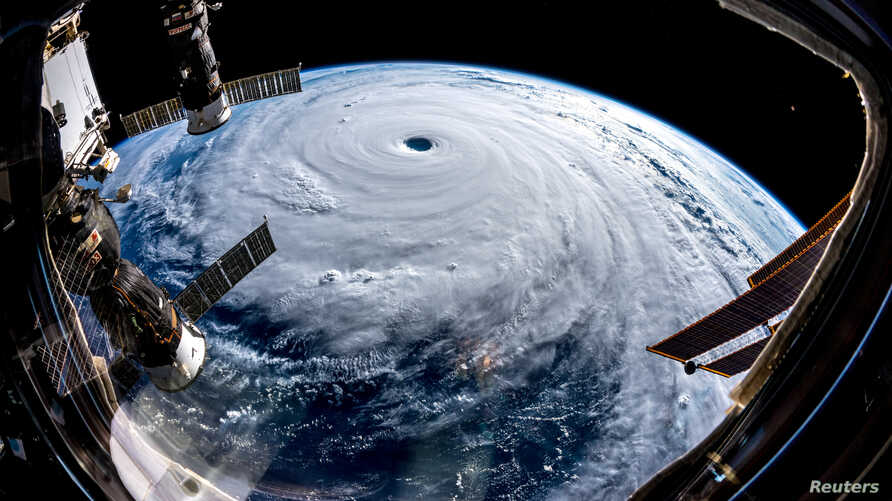Super Typhoon Trami is seen from the International Space Station as it moves in the direction of Japan, Sept. 25, 2018 in this image obtained from social media on Sept. 26, 2018.