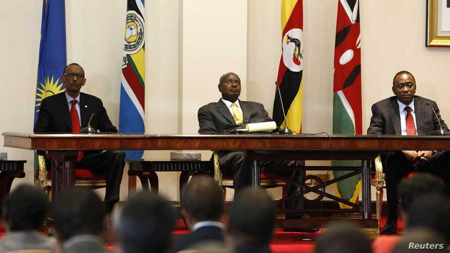 Three East African presidents, (from R) Uhuru Kenyatta of Kenya, Yoweri Museveni of Uganda and Paul Kagame of Rwanda, hold a joint news conference soon after their meeting in Entebbe, 36km (22 miles) southwest of the capital Kampala, June 25, 2013.