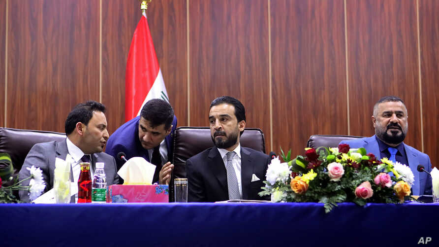 FILE - Iraqi Parliament Speaker Mohammed al-Halbousi, center, meets with Basra provincial Council members in Basra, 340 miles (550 km) southeast of Baghdad, Iraq, Sept. 18, 2018.