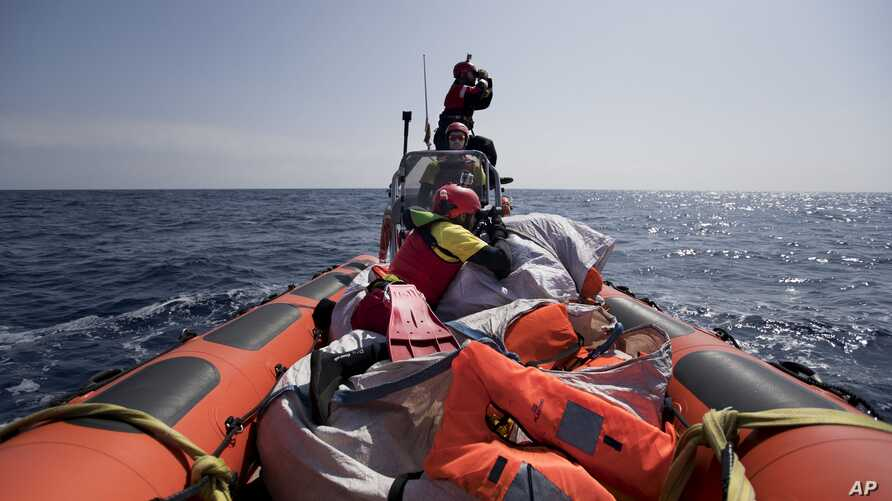 Proactiva Open Arms crew conduct a search-and-rescue operation in the Mediterranean Sea, 12 nautic miles from the Libyan coast, April 13, 2017.