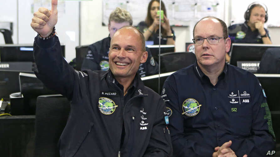 Swiss pilot and chairman of Solar Impulse Bertrand Piccard, left, gestures alongside Prince Albert II of Monaco as the solar-powered plane Solar Impulse 2 takes off from Nanjing, China, en route to Hawaii, at the Mission Control Center in Monaco, May