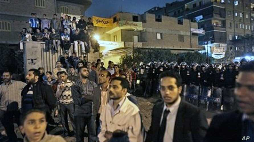 Hundreds of opposition Muslim Brotherhood supporters alleging electoral fraud make a standoff with riot police outside a counting center in the Shubra el-Kheima neighborhood of Cairo, Egypt, 28 Nov 2010