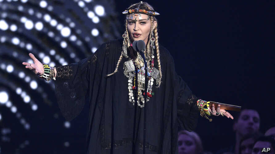 FILE - Madonna presents a tribute to Aretha Franklin at the MTV Video Music Awards at Radio City Music Hall on Monday, Aug. 20, 2018, in New York.