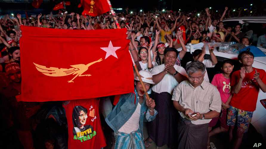Supporters of Myanmar's National League for Democracy party celebrate as election results are posted outside the NLD headquarters in Yangon, Myanmar, Nov. 9, 2015.