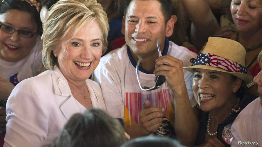 "FILE - Democratic U.S. presidential candidate Hillary Clinton poses with supporters after a ""Latinos for Hillary"" rally in San Antonio, Texas, Oct. 15, 2015."