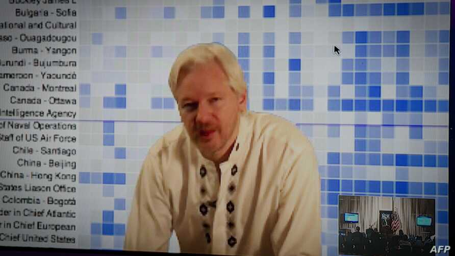 Julian Assange speaks during a teleconference between London and Washington on April 8, 2013