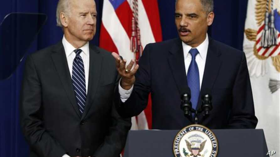 Vice President Joe Biden (left) with Attorney General Eric Holder April 9, 2013