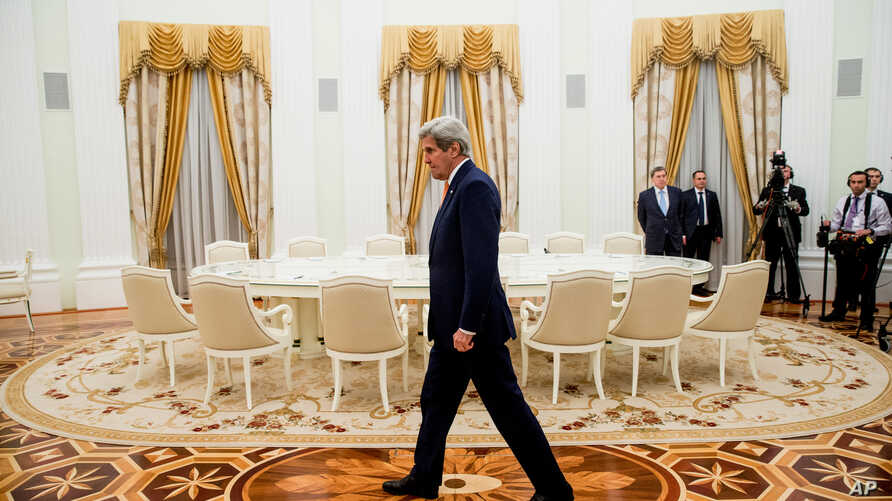 FILE - Secretary of State John Kerry arrives to meet with Russian President Vladimir Putin at the Kremlin in Moscow, Russia, March 24, 2016.