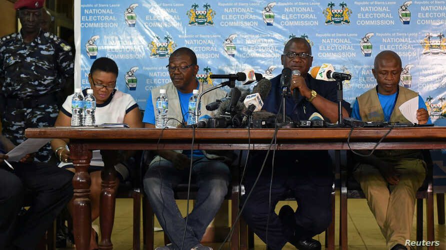 Chairman of Sierra Leone's National Electoral Commission, Mohamed Nfa'ali Conteh, announces the results of the first round of Sierra Leone presidential election in Freetown, Sierra Leone, March 13, 2018.