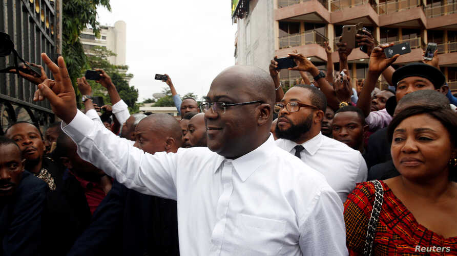 Felix Tshisekedi, leader of the Congolese main opposition party, the Union for Democracy and Social Progress who was announced as the winner of the presidential elections, gestures to his supporters in Kinshasa, Democratic Republic of Congo, Jan. 10,