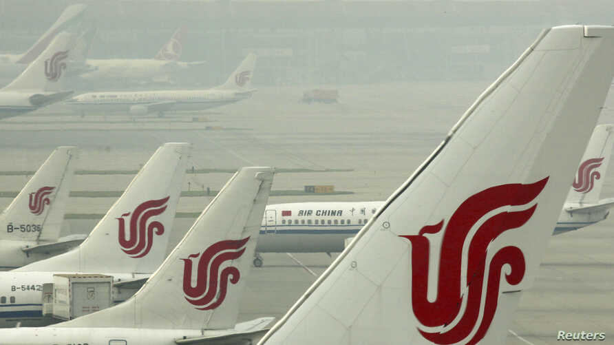 Air China planes are seen on the tarmac of the Beijing Capital International Airport, July 11, 2011.