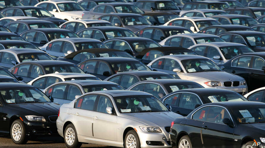 FILE - Imported German-made BMWs are parked at the North East Auto Terminal in Jersey City, N.J.