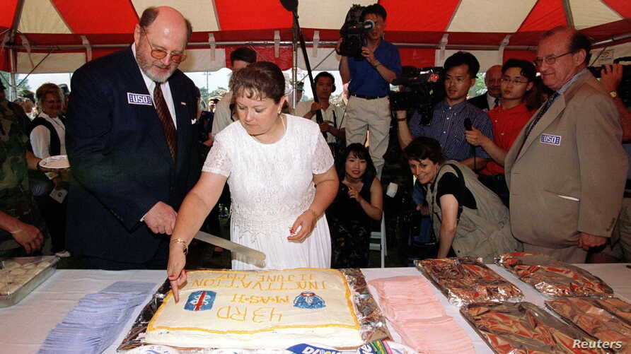 FILE - David Odgen Stiers cuts the cake during a ceremony marking the close of the last Mobile Army Surgical Hospital (MASH) in Pyongtaek, South Korea .