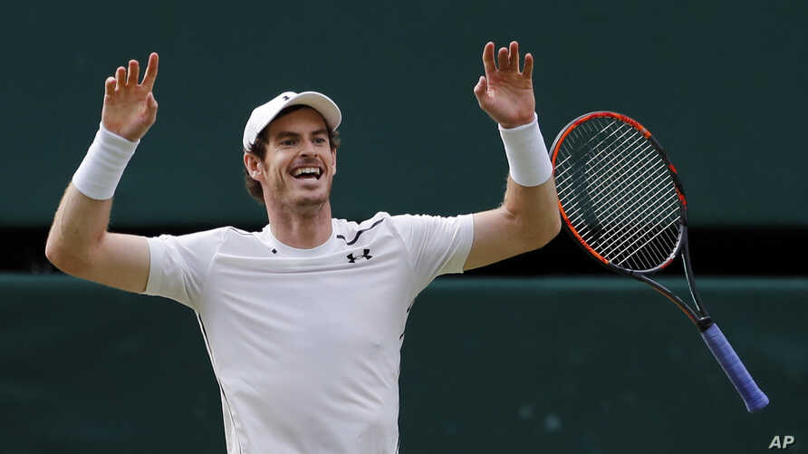 Andy Murray of Britain celebrates after beating Milos Raonic of Canada in the Wimbledon finals Sunday, July 10, 2016