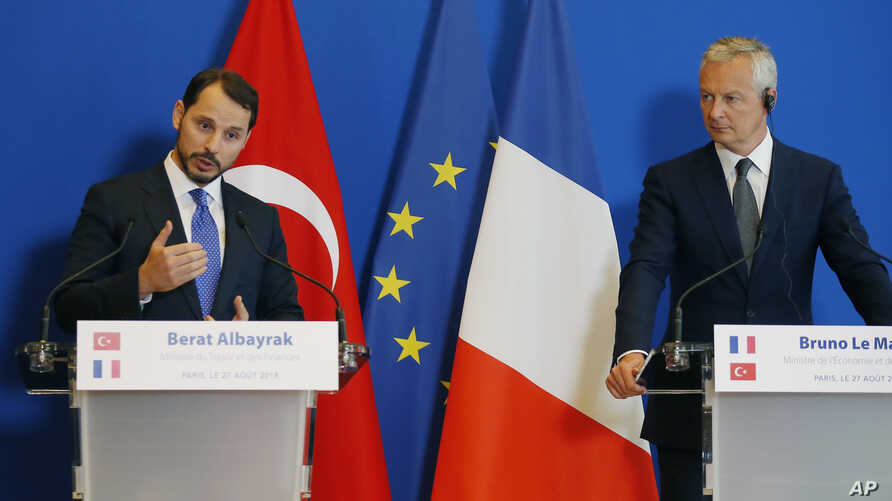 Turkey's Treasury and Finance Minister Berat Albayrak, left, and France's Finance Minister Bruno Le Maire make declarations to the media at the ministry in Paris, France, Aug. 27, 2018.