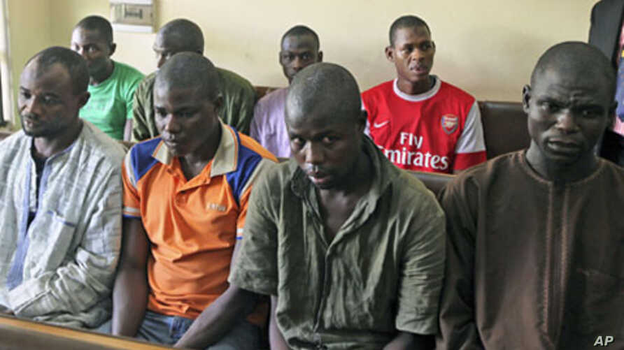 Men believed to be members of Islamist sect Boko Haram are suspected of being involved in a series of bomb attacks, wait for the start of a court session at the Wuse magistrate court in Nigeria's capital Abuja, September 13, 2011.