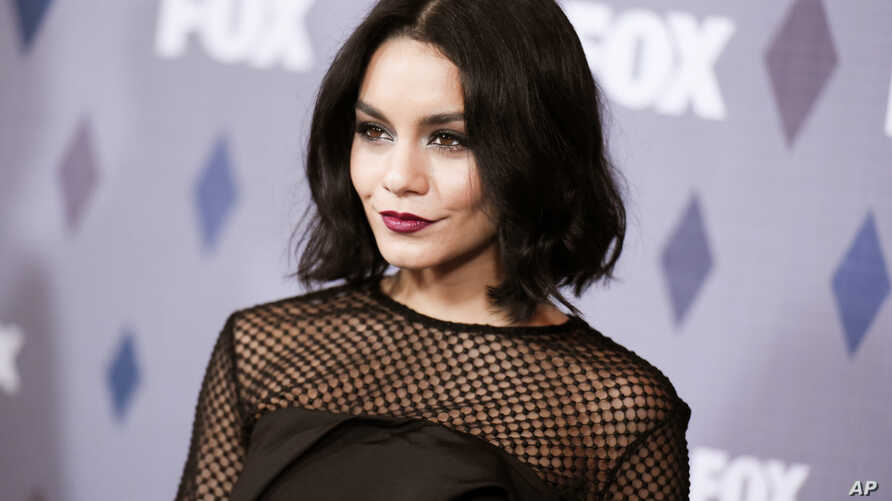 FILE - Actress Vanessa Hudgens in Pasadena, Calif. Hudgens has paid $1,000 in restitution for carving a heart into a red rock wall during a trip to Sedona, Ariz.