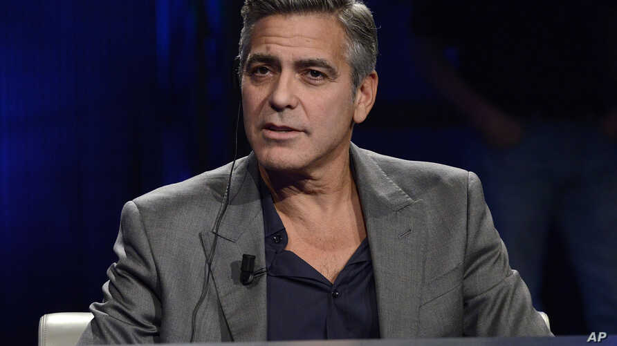 """FILE - George Clooney is interviewed on the Italian State RAI TV program """"Che Tempo che Fa,"""" in Milan, Italy, Feb. 9, 2014."""