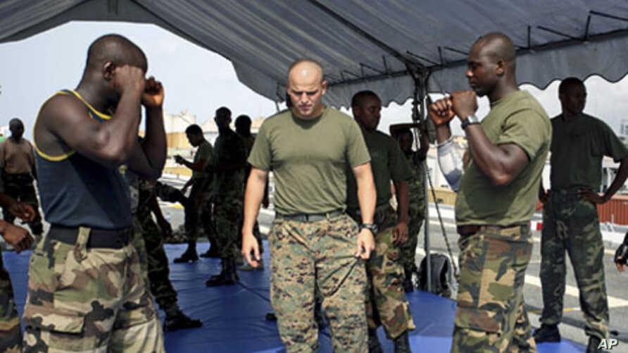 Nigerian navy officers undergo military exercises aboard USS Nashville as US Navy trains partners from around Africa's Gulf of Guinea to help boost maritime security in a region plagued by piracy, drug smuggling and raids on oil facilities, at the La