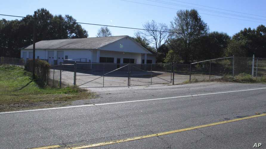 FILE - The building that once housed Superbike Motorsports sits empty in Chesnee, S.C. The building has been abandoned since four people who worked in the shop were shot to death in November 2003. Officials say the man arrested after they found a wom