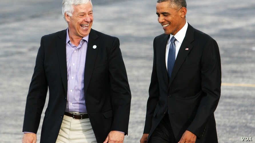 President Barack Obama walks across the tarmac with Maine Democratic gubernatorial candidate, Rep. Mike Michaud, after he arrived on Air Force One at the Portland International Jetport, Oct. 30, 2014.