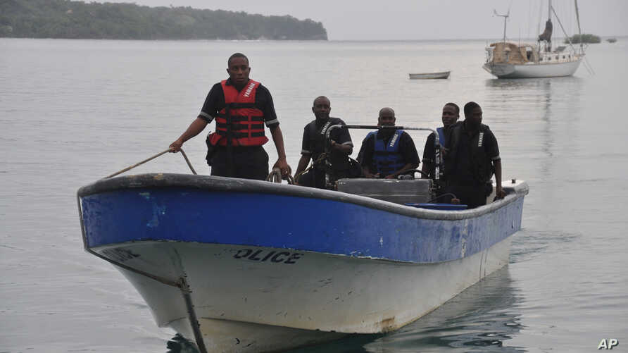 Jamaican Marine Police return to the Port Antonio Marina after a fruitless search for a plane that crashed into the ocean near Port Antonio, Jamaica, Sept. 5, 2014.