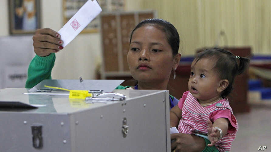 FILE - Cambodian woman votes in the senate election at Takhmau polling station in Kandal province, southeast of Phnom Penh, Cambodia, Feb. 25, 2018.