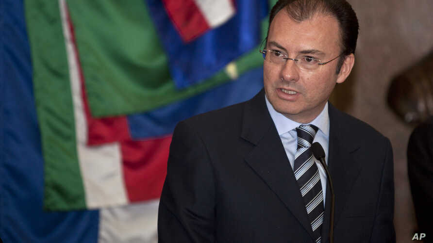 FILE - Mexico's Finance Minister Luis Videgaray Caso gives a press conference at the National Palace in Mexico City.