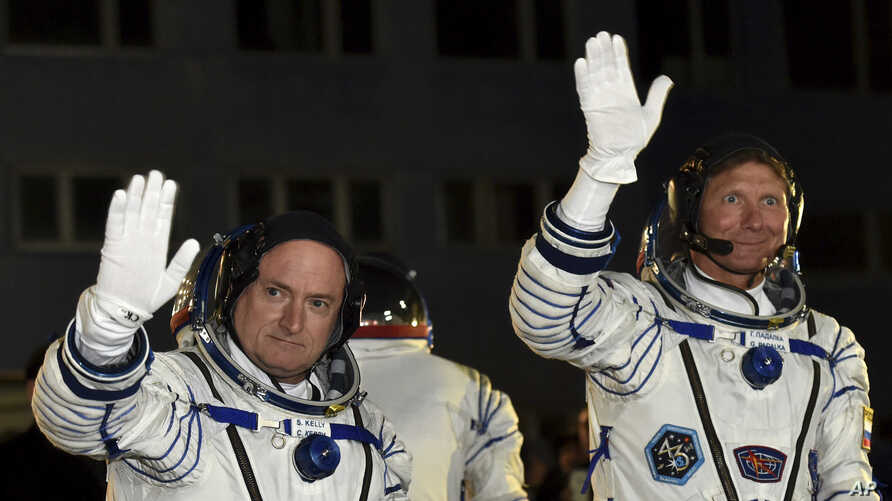 U.S. astronaut Scott Kelly, left, and Russian cosmonaut Gennady Padalka, crew members of the mission to the International Space Station, ISS, wave prior to the launch of Soyuz-FG  rocket at the Russian-leased Baikonur cosmodrome, Kazakhstan, March 27