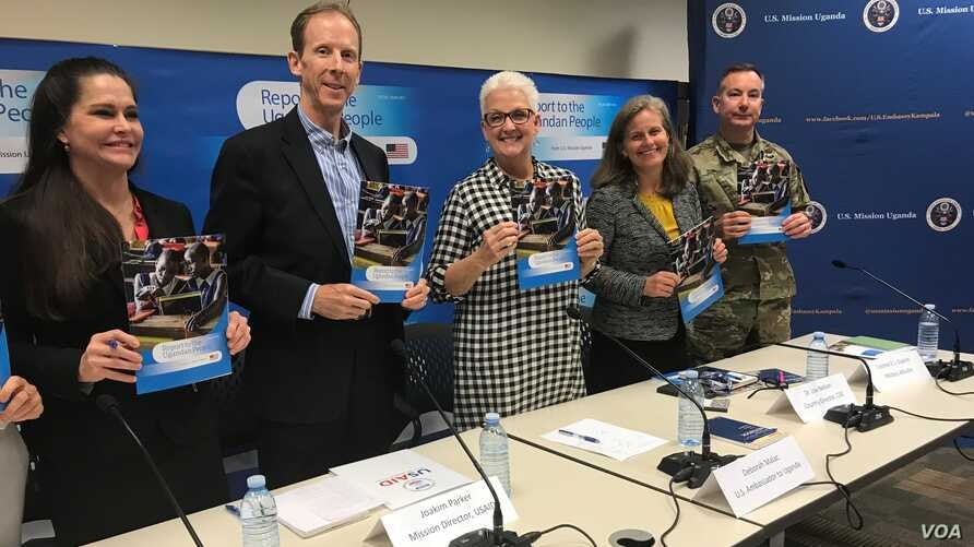 US Mission officials in Uganda led by Ambassador Deborah Malac (C) launch the second report on US Aid to Uganda, Aug. 2, 2018. (H. Alhumani for VOA)