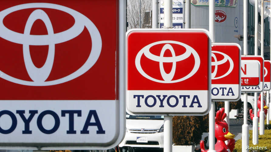 (File) Toyota Motor signboards are displayed at a dealer's shop in Yokohama, south of Tokyo.