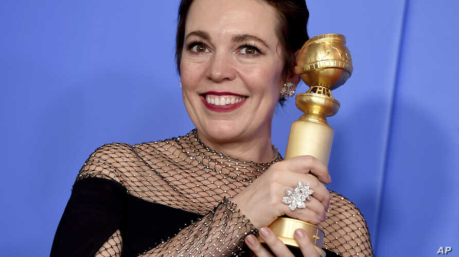 "FILE - Olivia Colman poses in the press room with the award for best performance by an actress in a motion picture, musical or comedy for ""The Favourite"" at the 76th annual Golden Globe Awards at the Beverly Hilton Hotel in Beverly Hills, Calif., Jan"