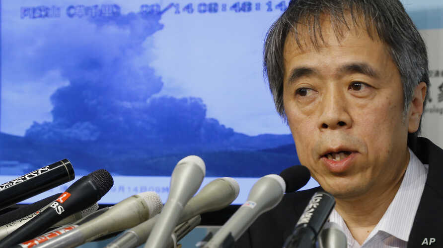 FILE - Japan's Meteorological Agency Volcanology Division Director Sadayuki Kitagawa speaks during a news conference on the eruption of Mount Aso.