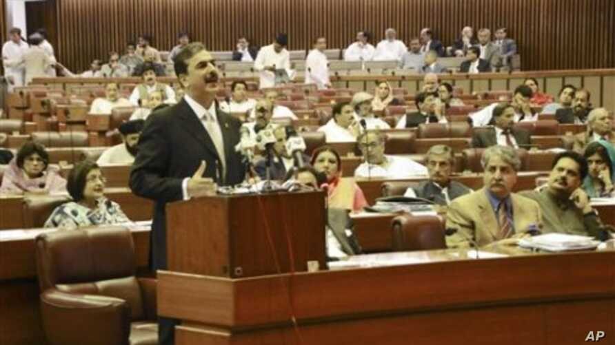 In this photo released by Pakistan's Press Information Department, Pakistani Prime Minister Yousuf Raza Gilani delivers a speech at the parliament house in Islamabad, Pakistan, May 9, 2011