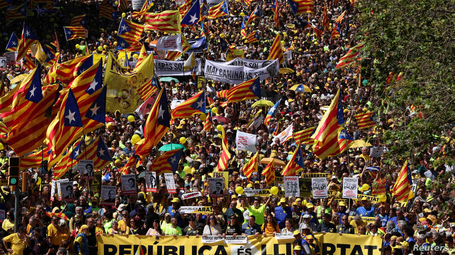 Pro-independence supporters march as they attend a demonstration in Barcelona, Spain, April 15, 201