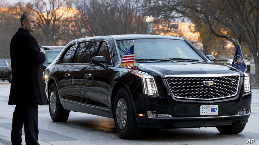 """A presidential limo known as """"The Beast"""" carrying President Donald Trump and first lady Melania Trump arrives outside Blair House across the street from the White House in Washington, Dec. 4, 2018."""