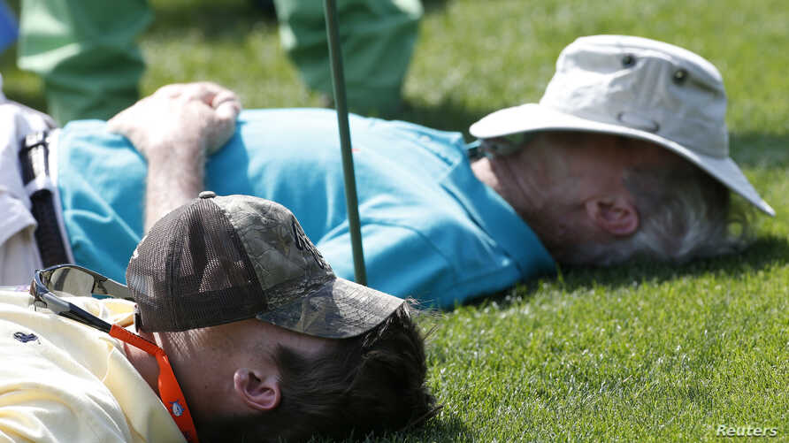 File - Spectators sleep on the 15th tee during Masters golf tournament in Augusta, Georgia April 11, 2014.